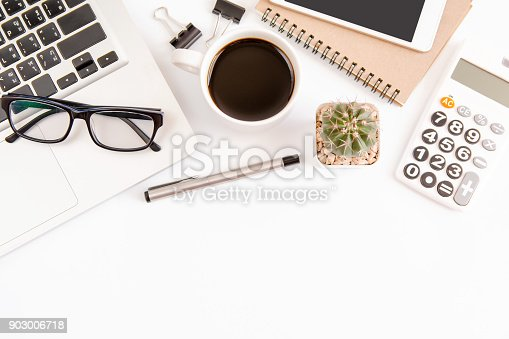 604021340 istock photo White office desk table, workspace office with laptop, smartphone black screen,pen,calculator, glasses, Top view with copy space 903006718
