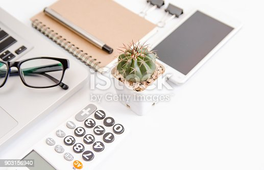 604021340 istock photo White office desk table, workspace office with laptop, smartphone black screen,pen,calculator, glasses, Top view with copy space 903156940
