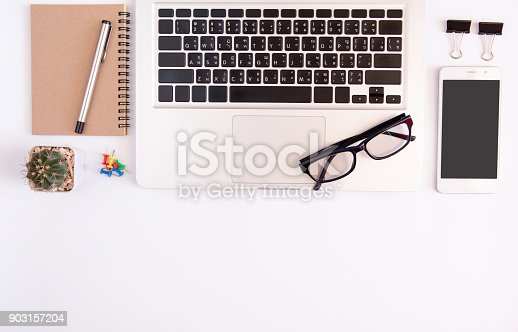 604021340 istock photo White office desk table, workspace office with laptop, smartphone black screen,pen,calculator, glasses, Top view with copy space 903157204