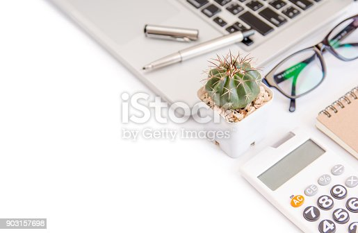 604021340 istock photo White office desk table, workspace office with laptop, smartphone black screen,pen,calculator, glasses, Top view with copy space 903157698