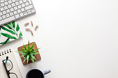 istock White office desk with copy space. Open notebook, keyboard, coffee and succulent. 1277758901