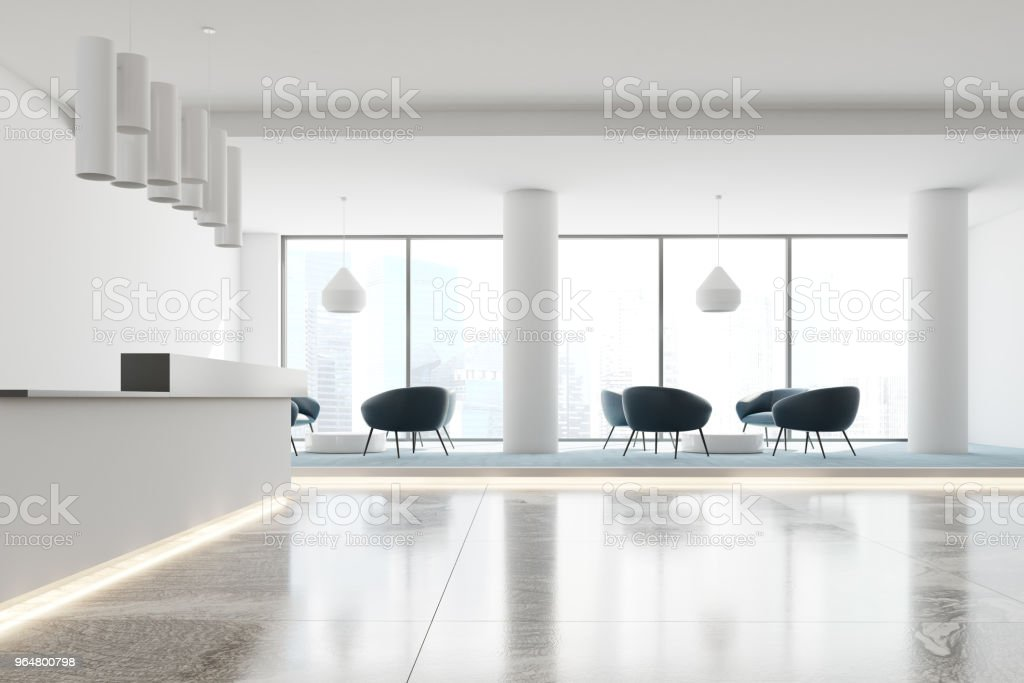White office reception desk and waiting area side royalty-free stock photo