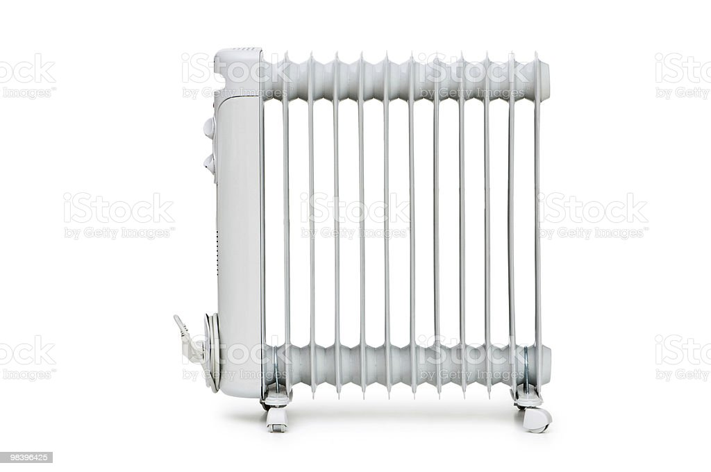 A white oil radiator on a white background royalty-free stock photo