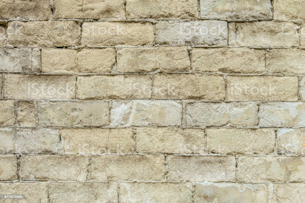 White old brick wall texture. Background of weathered, thawed and cracked silicate brick wall. stock photo