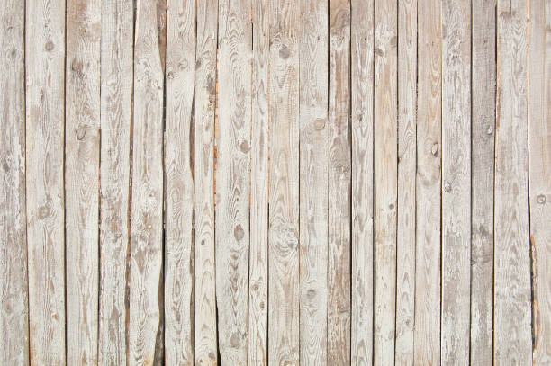 white old wooden fence. wood palisade background. - palisade boundary stock photos and pictures