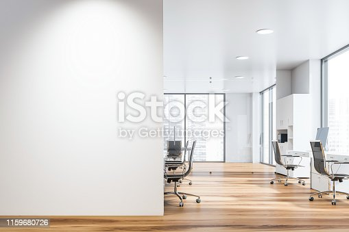 Interior of open space office of modern company with rows of computer desks and meeting room. Mock up wall on the left. 3d rendering