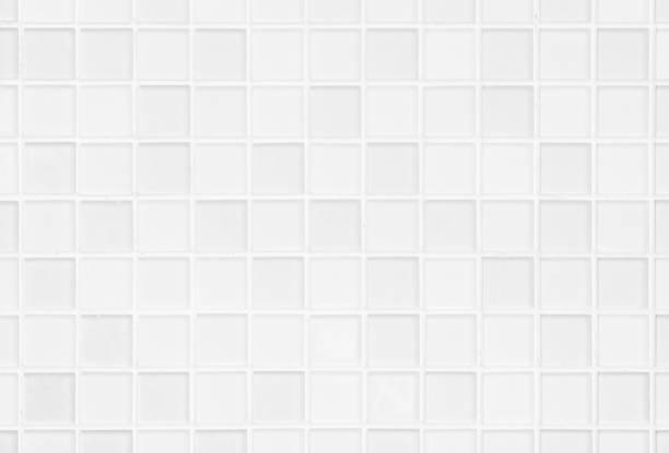白いか灰色の陶磁器の壁および床のタイルの抽象的な背景。寝室の装飾のための幾何学的なモザイクテクスチャを設計します。背景広告バナーポスターやウェブのためのシンプルなシームレ� - タイル ストックフォトと画像