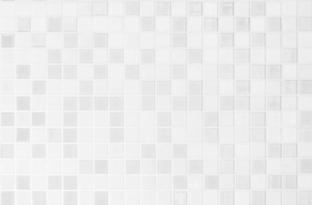 白または灰色のセラミック壁と床タイル抽象的な背景。寝室の装飾のための幾何学的なモザイクの質を設計します。背景広告バナーポスターやウェブのためのシンプルなシームレスなパター� - タイル ストックフォトと画像
