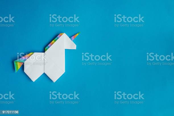 White origami unicorn on blue background picture id917011136?b=1&k=6&m=917011136&s=612x612&h=jh4jzoocwsw hi5gr fgmxwrupv2ivqy4b3eda rl3a=