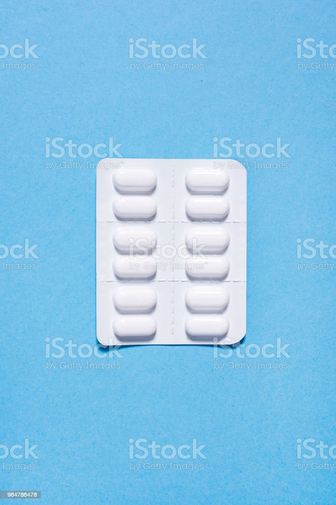 White packaging of tablets in capsules royalty-free stock photo