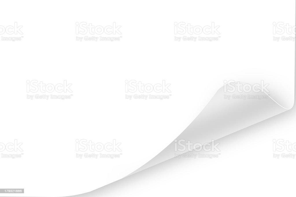 White page with corner curled over white backdrop stock photo
