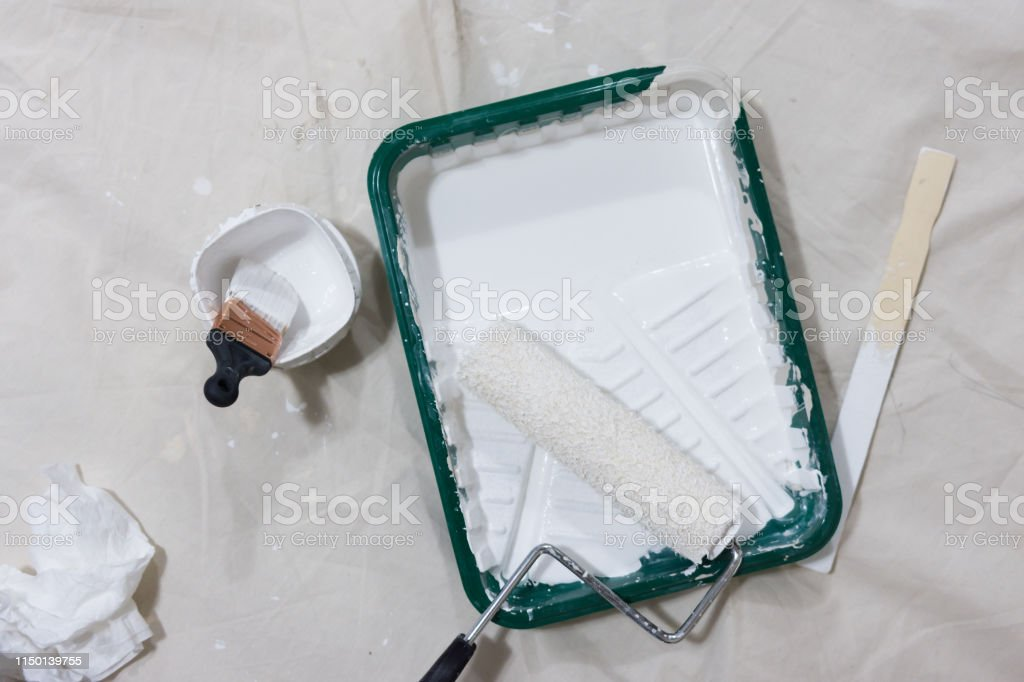 White paint, roller, brush, stir stick, pan, for painting white...