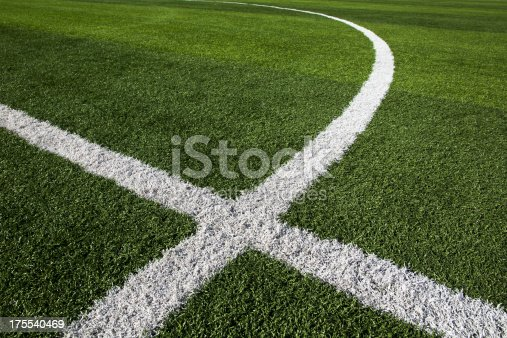 istock White paint dividers in grass of soccer field 175540469