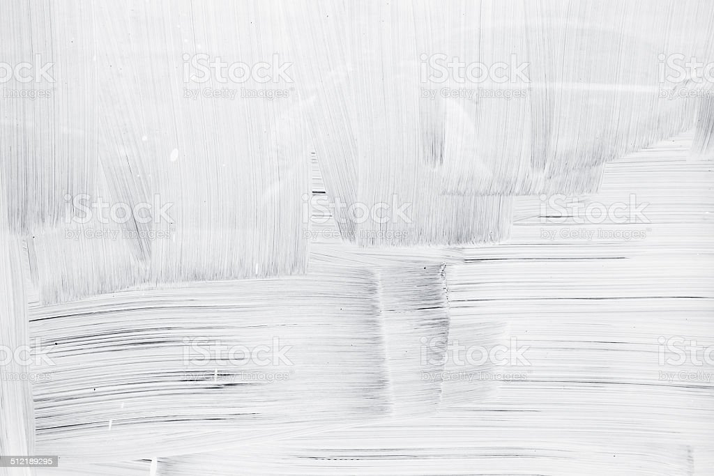 White paint layer on glass wall, background texture stock photo