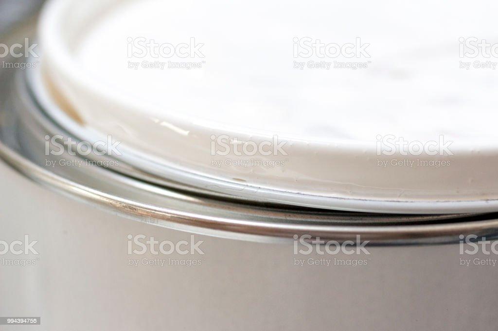 White paint on lid paintcan stock photo