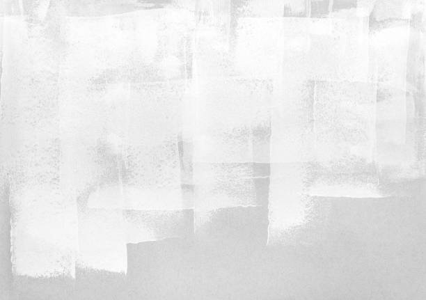 white paint roller strokes on grey paper stock photo