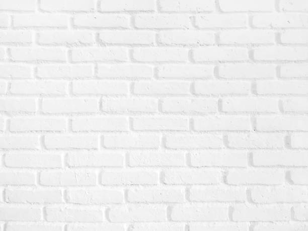 White painted brick wall background stock photo