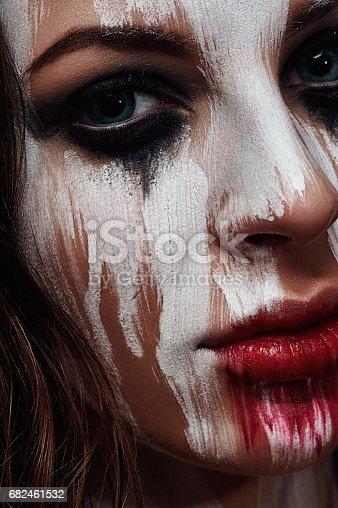 istock White painted Face of brunette Girl 682461532