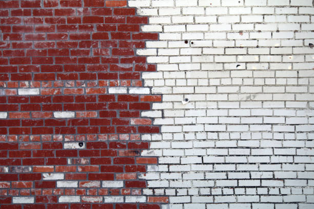 white painted red brick garden wall vintage contrast stock photo
