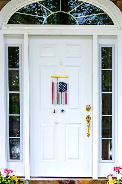 White painted residential front door on July 4th stock photo