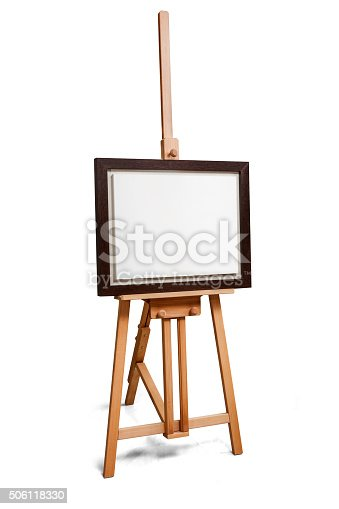 istock White painter canvas in frame on wooden easel 506118330