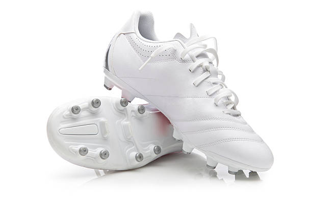 White pair of soccer shoes in white background White soccer sport shoes on white background studded stock pictures, royalty-free photos & images