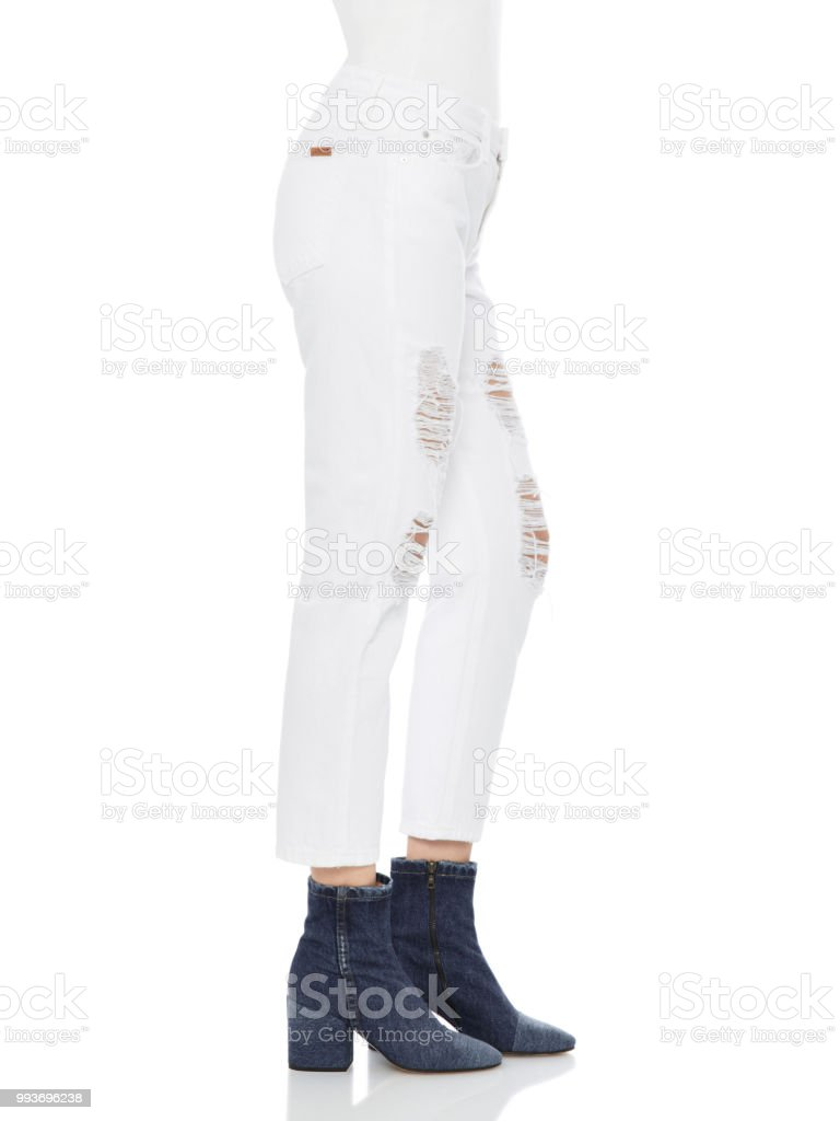 white pants with full sleeve top and with white background stock photo
