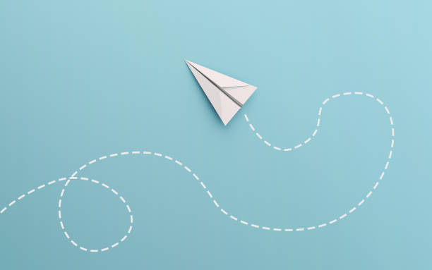 white paper airplane path and route line isolated on blue background in education or travel concept. mock up design. 3d abstract illustration - paper airplane stock photos and pictures
