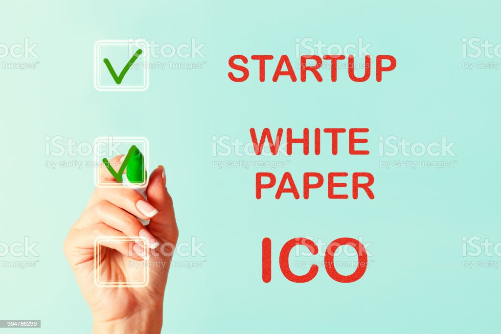 White paper and ICO royalty-free stock photo
