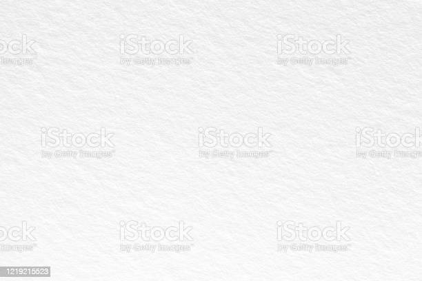 Photo of White paper background. Can be used as texture in art projects.