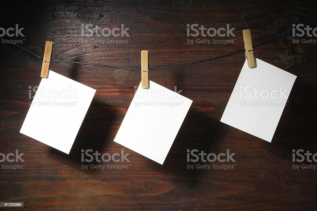 white   paper clothes-peg rope royalty-free stock photo