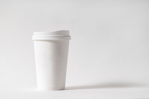 white paper cup on white background.