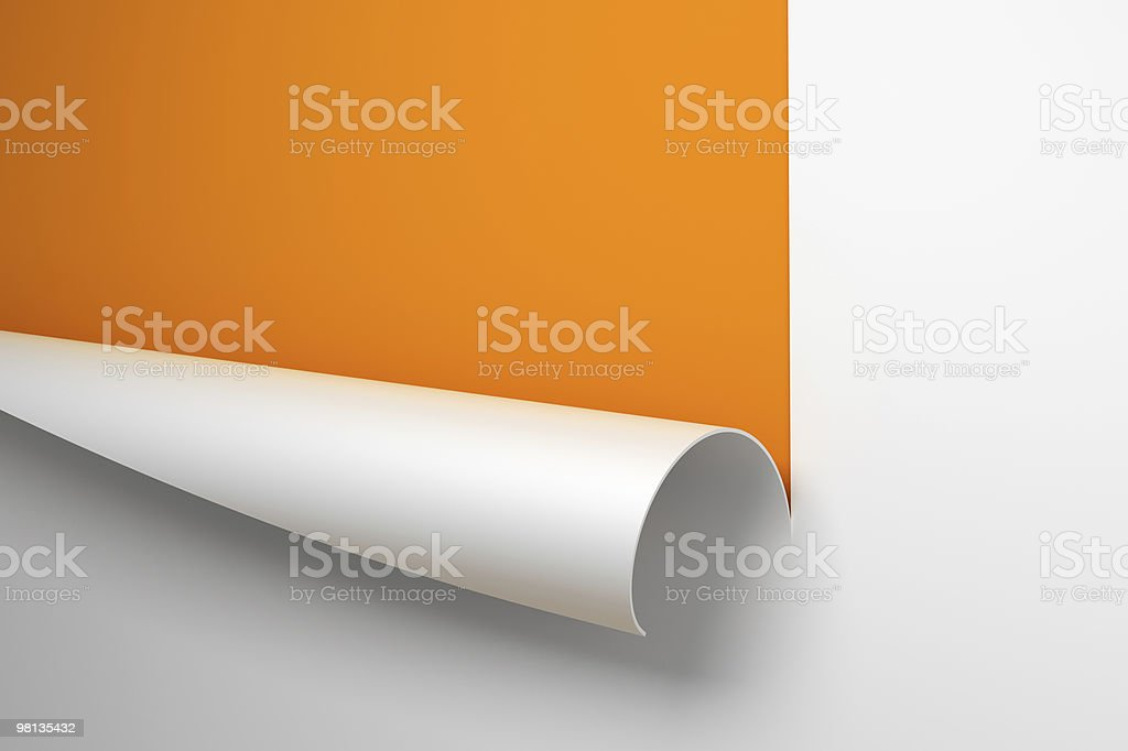 White paper cut and curled back to reveal orange background stock photo