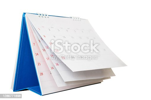 White paper desk calendar flipping page mockup isolated on white background with clipping path