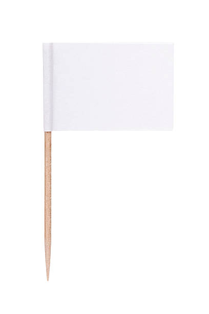 White paper flag with toothpick pole stock photo