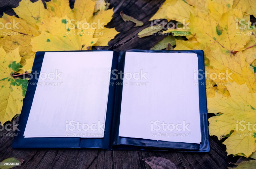 white paper for notes on a wooden table royalty-free stock photo