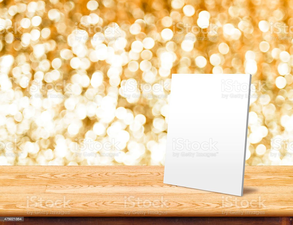 White paper frame at marble Table with bokeh sparkling background stock photo