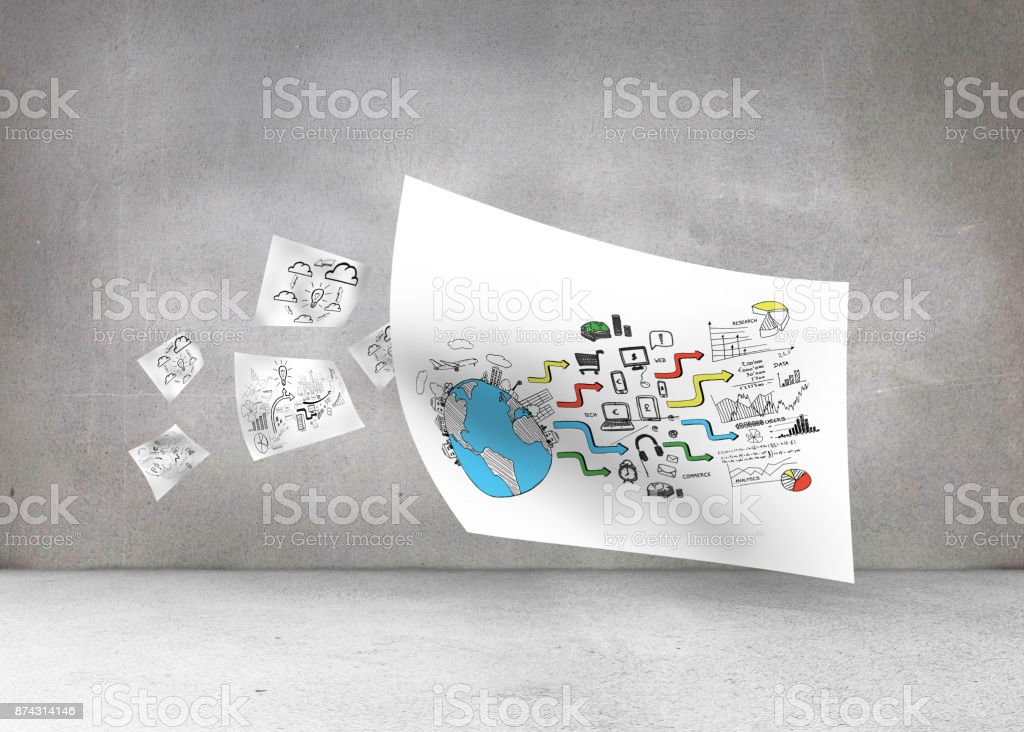 White paper in front of grey wall stock photo