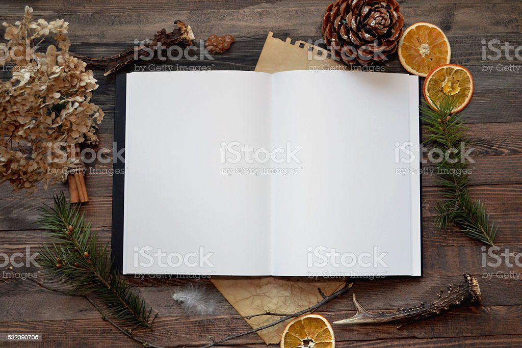 White paper mock up on rustic wood background stock photo