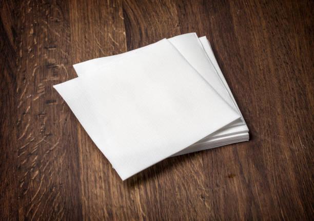white paper napkin on  table stock photo