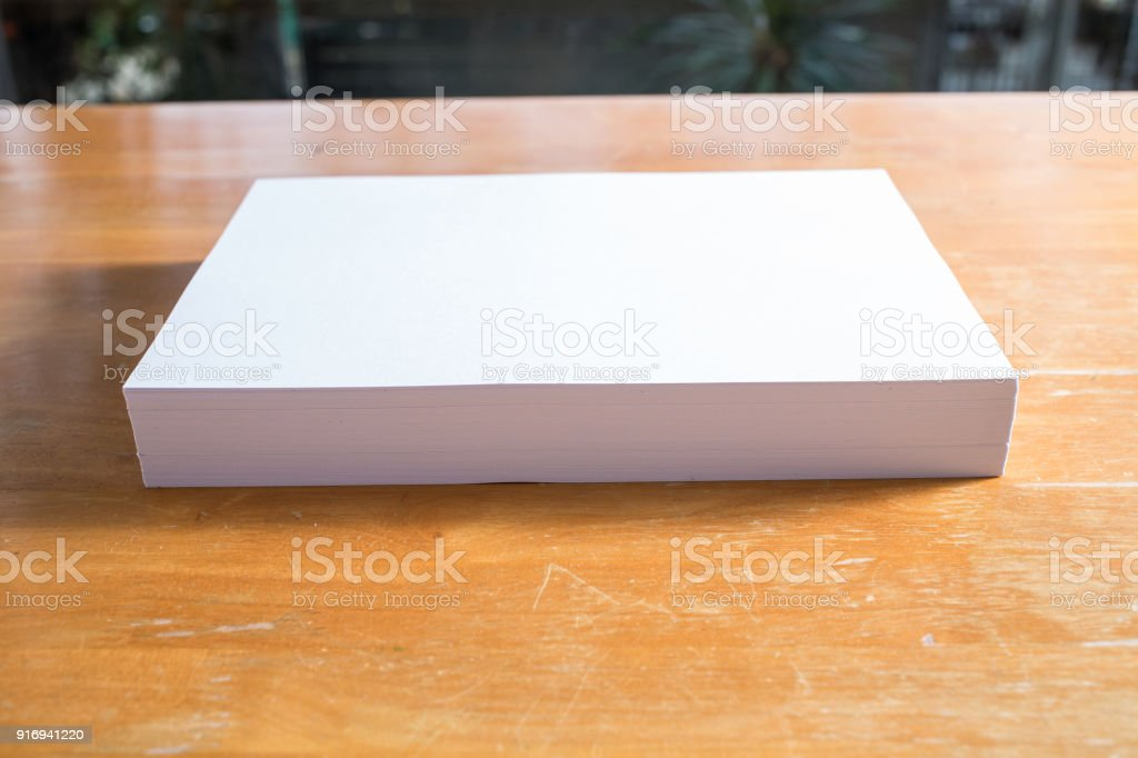 White paper on wood table stock photo