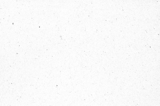 White paper or cardboard texture with black spot background.