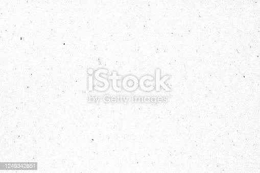 istock White paper or cardboard texture with black spot background. 1249342651