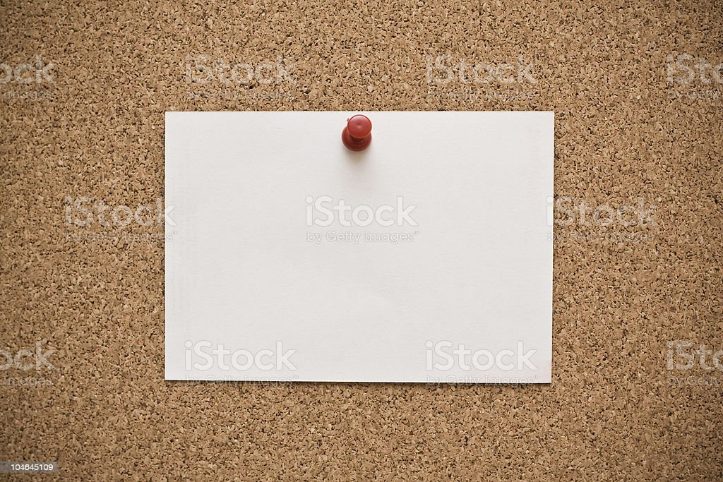 White paper pinned to corkboard royalty-free stock photo