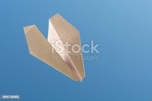 istock white paper plane on blue sky 688236860
