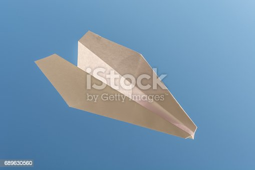istock white paper plane on blue sky 689630560