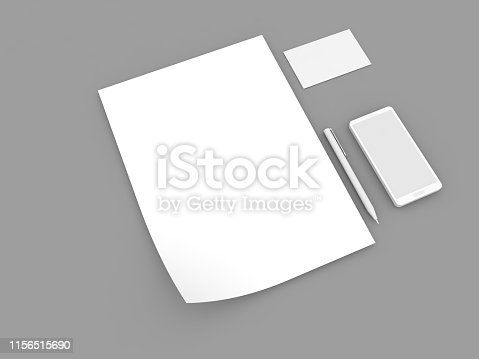 istock White paper sheet, mobile phone business card and pen . 1156515690