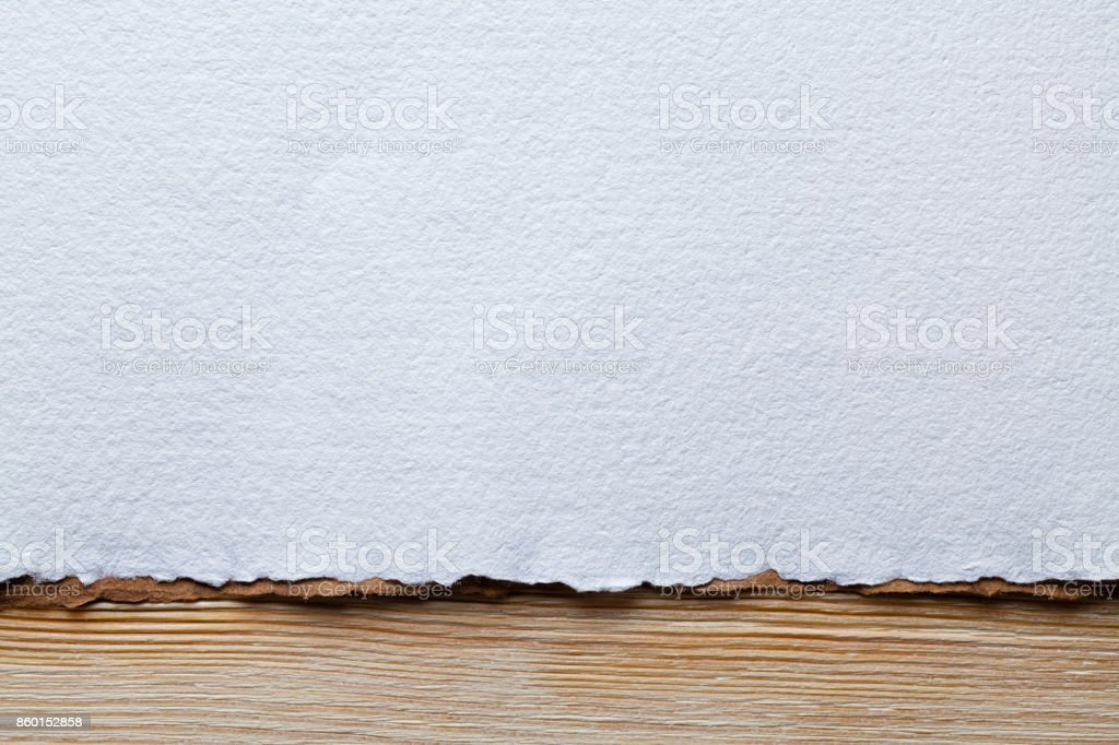 White paper sheet on wooden planks stock photo
