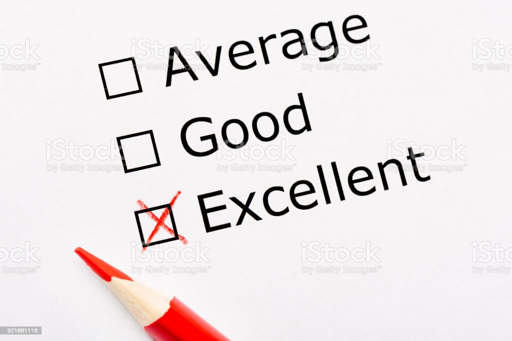 White paper sheet with checkboxes and red pencil. Survey asks the persons opinion whether it is average, good or excellent. Customer satisfaction stock photo