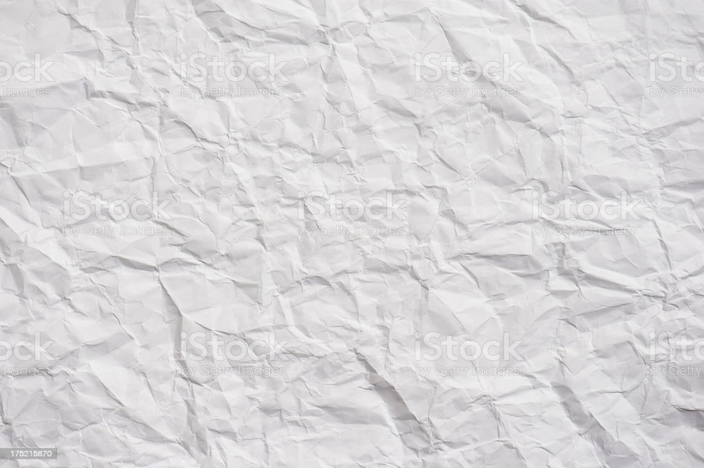 White paper that has been crumpled and then folded back out stock photo